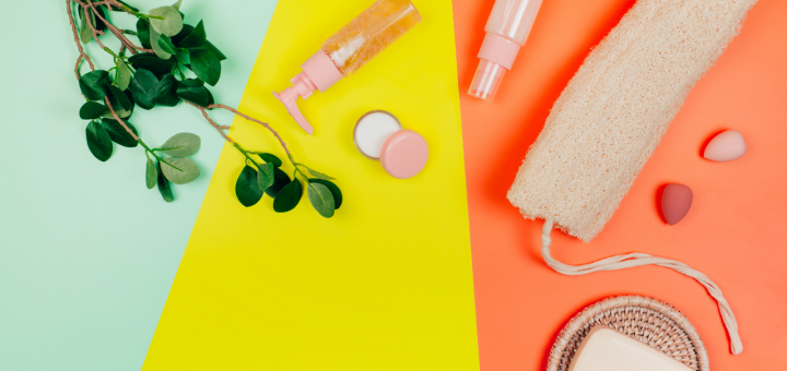 Self-care beauty products are laid out over a stripy background. Photo.